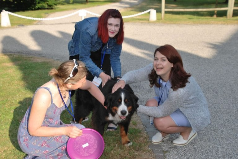 Young Investigators at a recent Summer School take part in outdoor activities with a canine companion