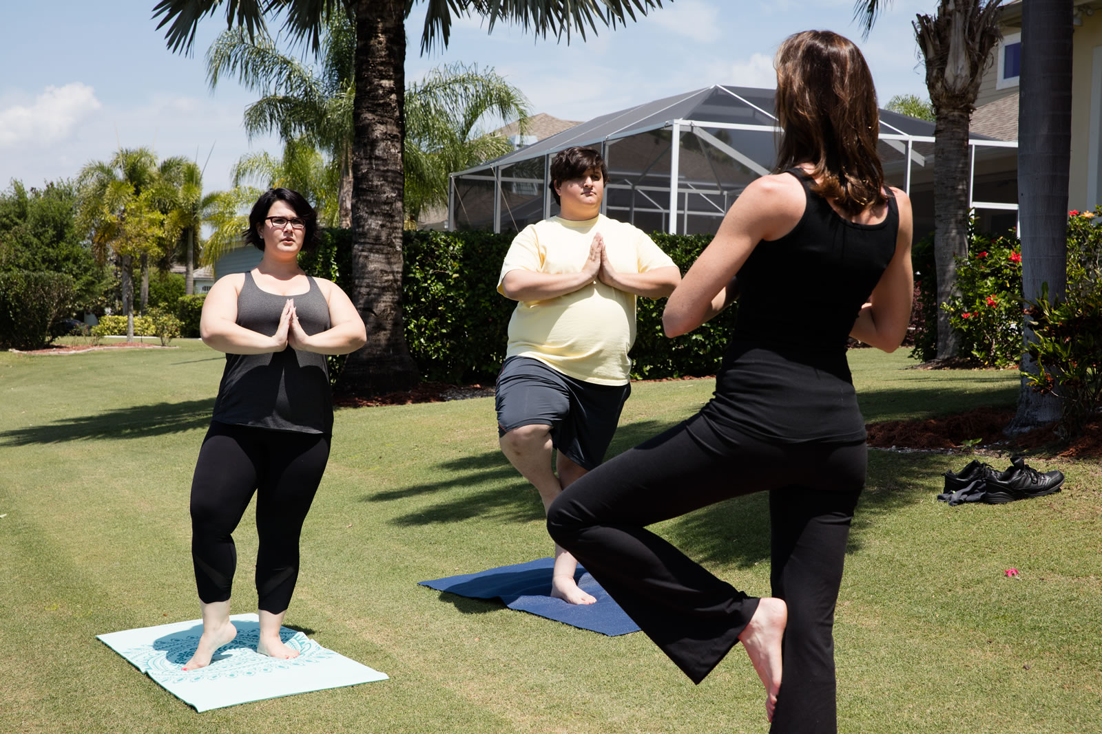 A couple attend a yoga class