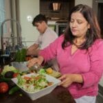 Woman and boy preparing dinner